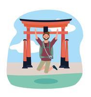 Homem pulando na frente da escultura de Tóquio