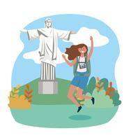 Mulher pulando com Cristo Redentor no fundo