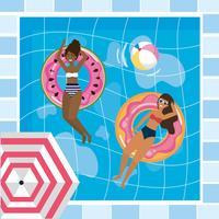 Vista aérea de duas mulheres em carros alegóricos de piscina