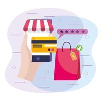 Mão segurando o smartphone com cartão de crédito e sacola de compras vetor