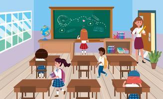 Parte traseira dos alunos em sala de aula com o professor