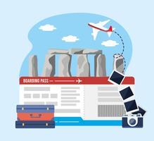 Stonehenge com bilhetes de avião com câmera com mala
