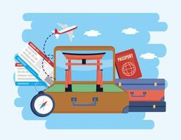 Mala com escultura de Tóquio e malas com passaporte