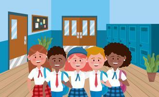 Grupo de estudantes em uniformes escolares na escola vetor