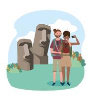 Casal na frente de estátuas da ilha de Páscoa vetor