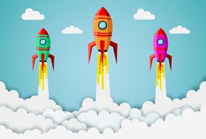 Foguetes voando no céu entre nuvens