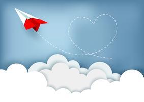Avião de papel com trilha em forma de coração vetor