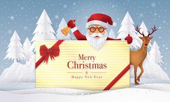 Papai Noel e renas segurando presente com cartão de feliz Natal