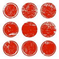 Conjunto de círculos de textura grunge vermelho vetor