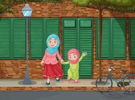 Meninas muçulmanas de mãos dadas na calçada vetor