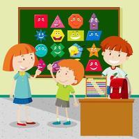 Alunos aprendendo formas em sala de aula vetor