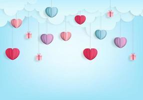 Papel de balão de corações dos namorados corta estilo no fundo do céu azul