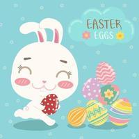 cartão de Páscoa colorido com coelho, ovos e texto vetor