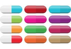 Vetores de comprimidos coloridos e brancos