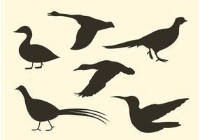 Pacote grátis de silhueta de pássaros vetor