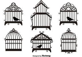 Silhuetas de gaiolas de pássaros vintage vetor