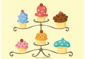 Vetor de carrinho de cupcake saboroso