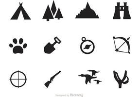 Vetores do ícone do acampamento e da caça