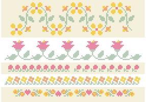 Conjunto de borda de flores de ponto de cruz vetor