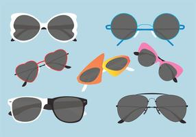 Conjunto de óculos de sol dos anos 80 em formato vetorial vetor
