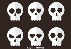 Ícones planos de crânio branco vetor