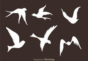 Vetores de silhueta do pássaro voador