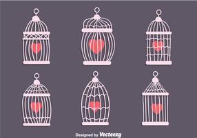 Gaiola de pássaro vintage com vetores de forma de coração