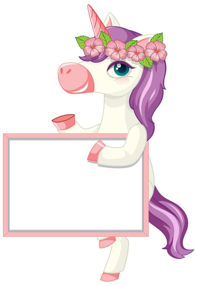 unicorno carino che tiene uno striscione bianco vettore