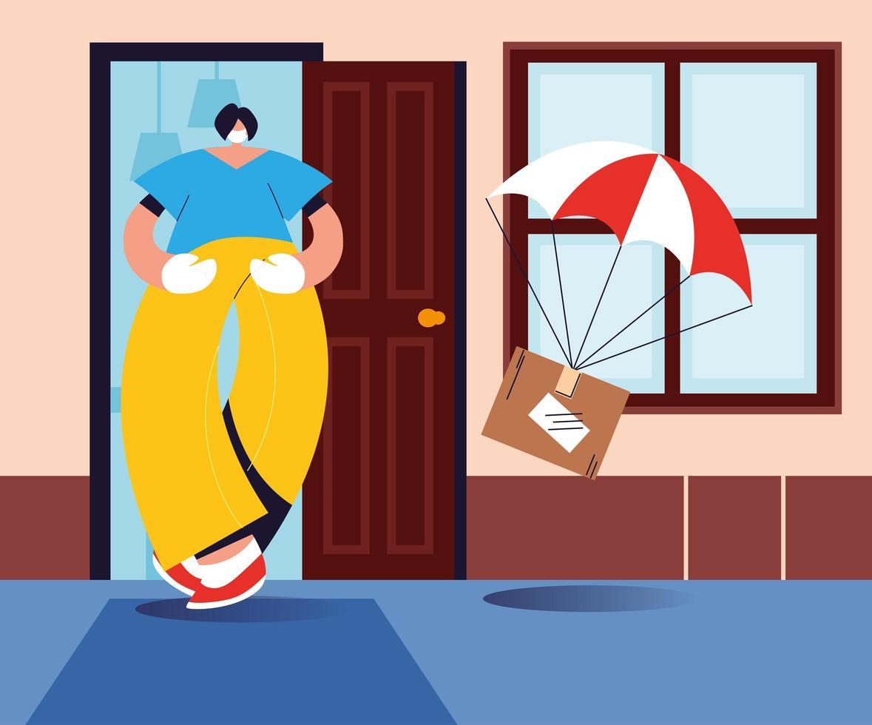 uomo che cattura cassetta dei pacchi che cade con il paracadute vettore