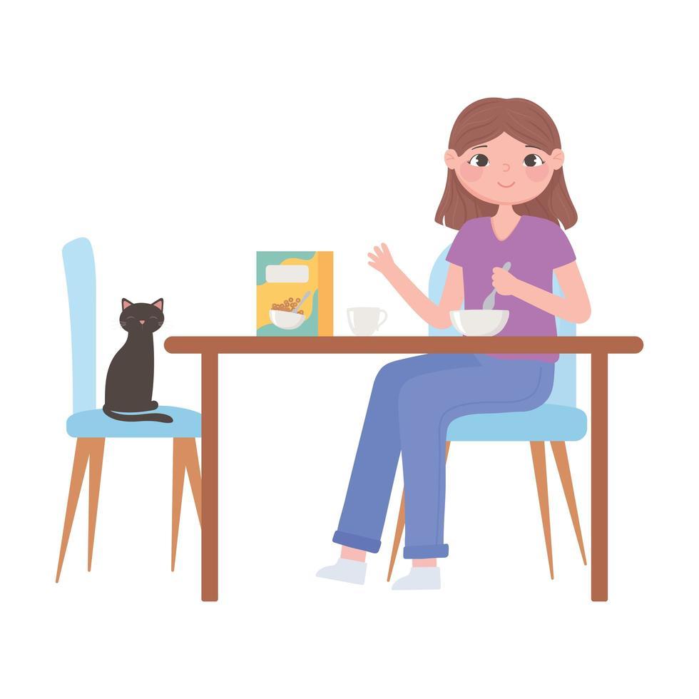 ragazza con il gatto al tavolo mangiare la colazione a base di cereali vettore