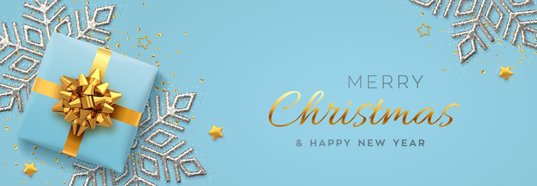 banner di Natale. confezione regalo blu con fiocco dorato vettore