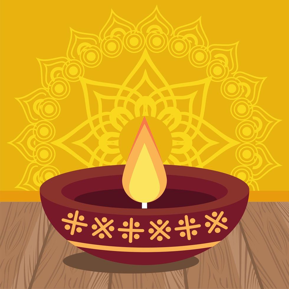 celebrazione felice diwali con candela in sfondo giallo vettore