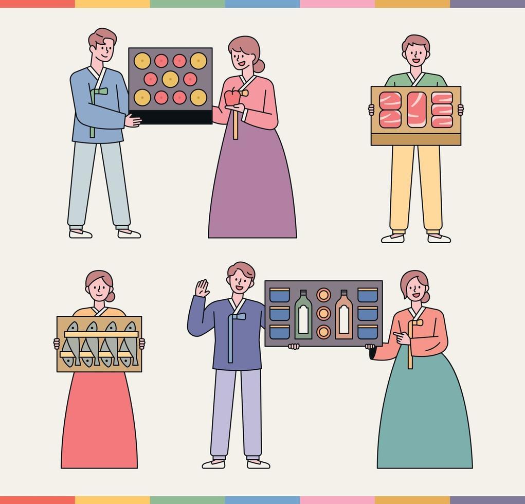 un set regalo che i coreani adorano. persone in costumi tradizionali coreani mettono in mostra articoli da regalo. vettore