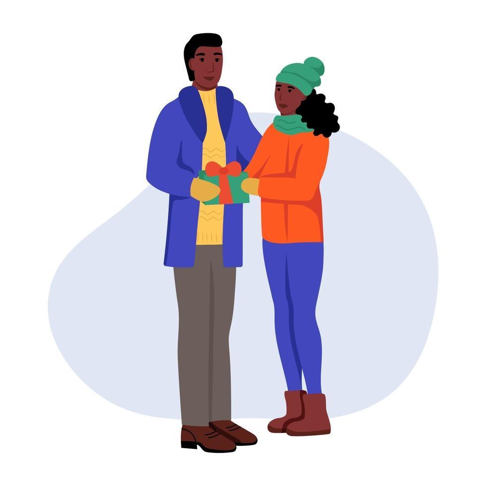 un giovane uomo e una donna in abiti invernali con doni in mano. una coppia innamorata si scambia regali. illustrazione vettoriale di cartone animato piatto. San Valentino