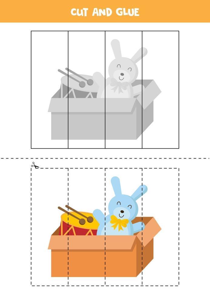 gioco da tagliare e incollare con scatola con coniglio giocattolo e tamburo. vettore