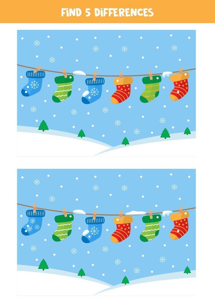trova 5 differenze tra due immagini con i calzini appesi. vettore