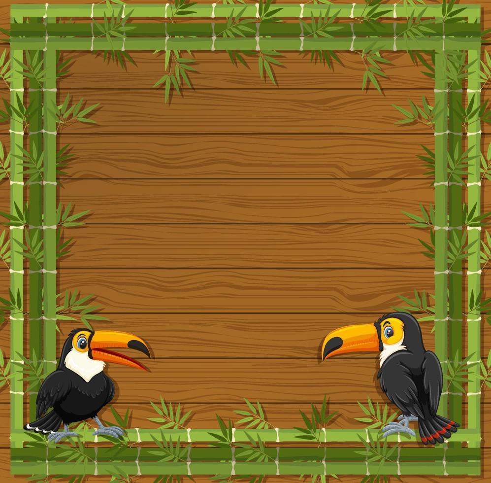 banner vuoto con cornice di bambù e personaggio dei cartoni animati tucano vettore