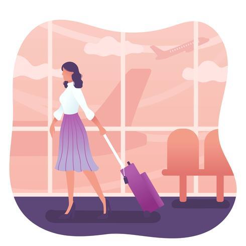 Donna con il vettore di valigia