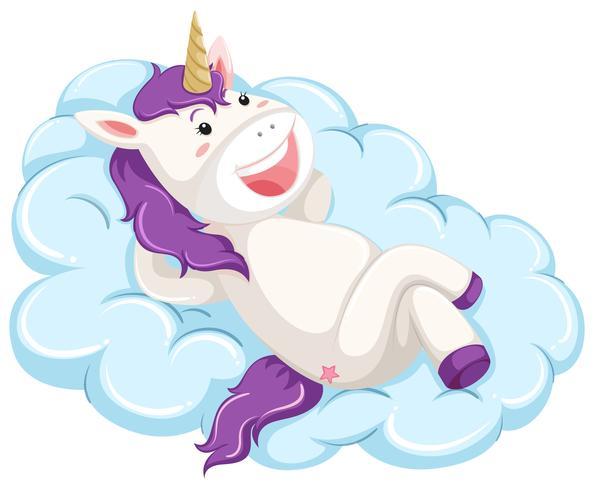 Un unicorno giaceva sul cloud vettore