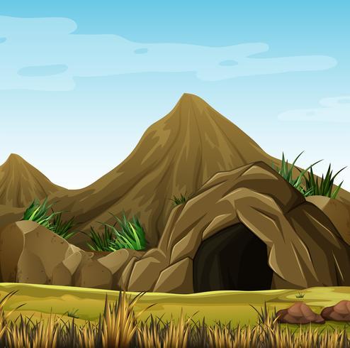 Scena con grotta nella montagna vettore