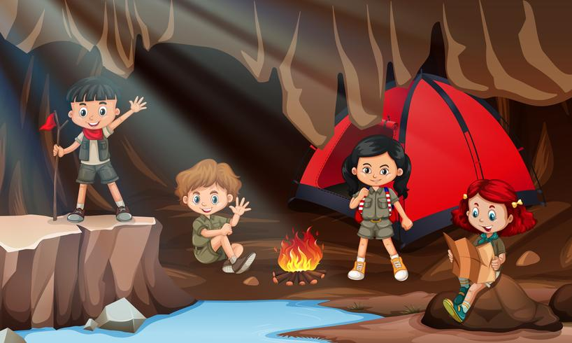 Bambini che accampano in una grotta vettore