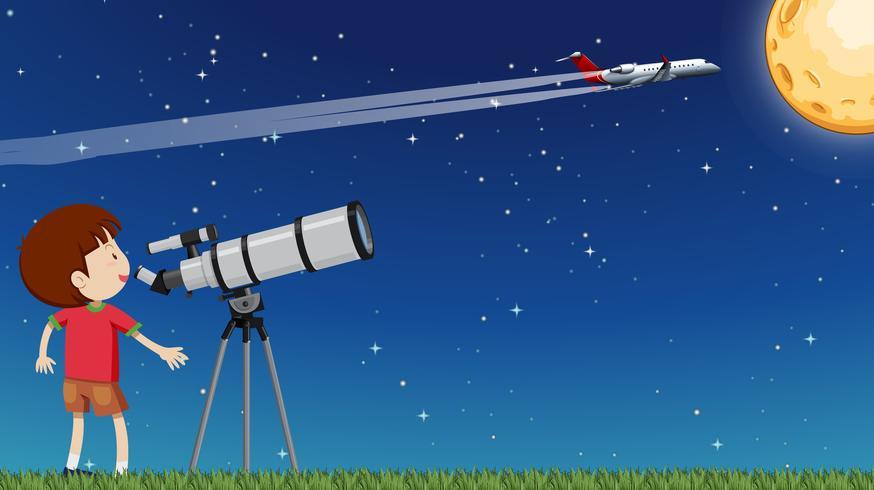 Un bambino che guarda la luna con il telescopio vettore