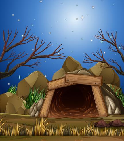 Una grotta mineraria di notte vettore