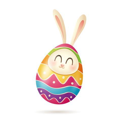 Coniglietto di Pasqua all'interno di uova dipinte vettore