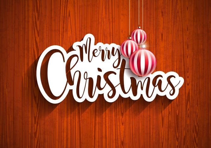 Illustrazione dell'iscrizione della mano di Buon Natale con l'etichetta di carta e le palle di vetro ornamentali rosse su fondo di legno d'annata. Disegno di festa di vettore ENV 10.