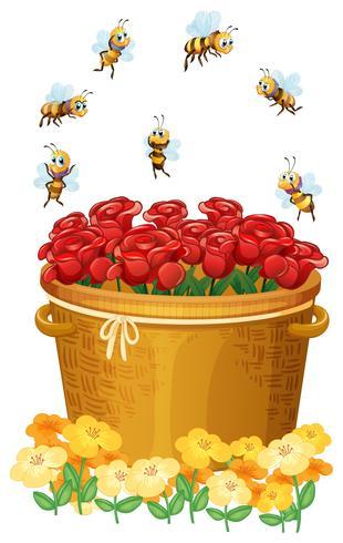 Un cesto di rose rosse con api vettore
