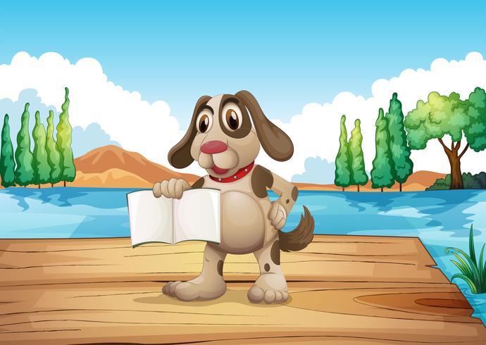 Un cane in possesso di un libro vuoto in piedi al porto vettore