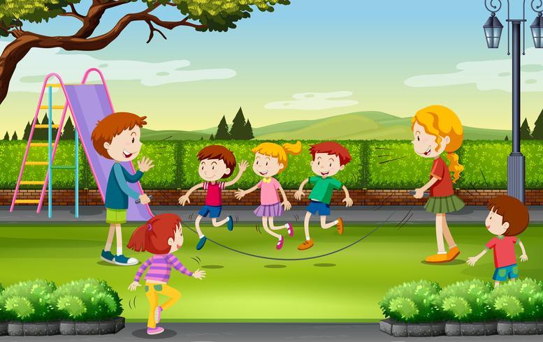 I bambini saltano la corda nel parco vettore