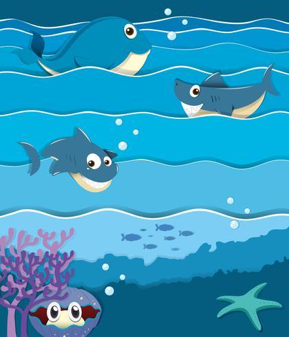 Animali marini sotto l'oceano vettore