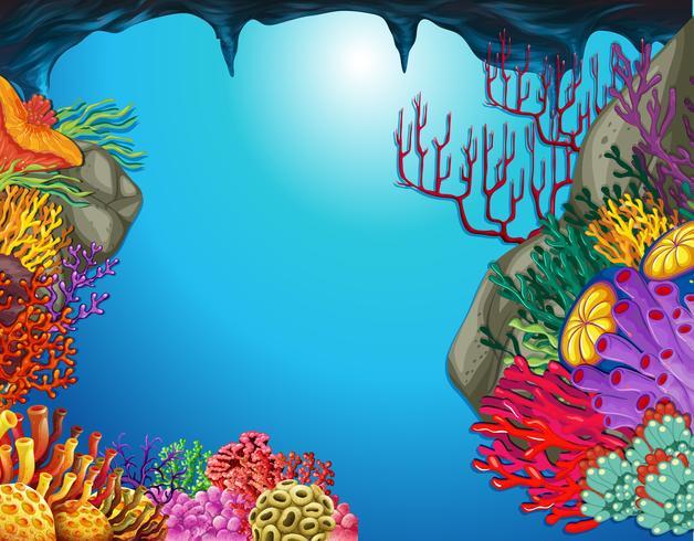 Scena subacquea con barriera corallina in grotta vettore